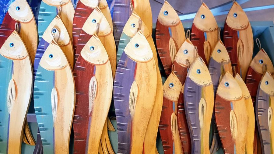 Wooden fish No People Large Group Of Objects Full Frame Multi Colored Choice Day Wood - Material Side By Side Representation Close-up Abundance Animal Representation In A Row High Angle View Backgrounds Variation Repetition Yellow Outdoors Market