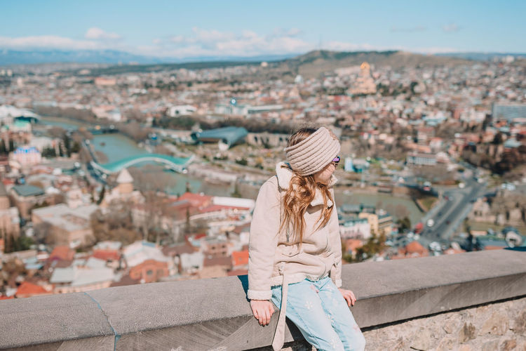 High angle view of woman looking at cityscape
