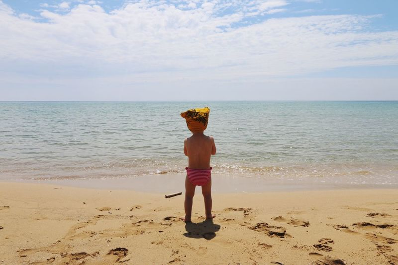 A lot to discover Life Is A Beach Italy Holiday POV Holiday Beach Land Sea Water Horizon Over Water Sky One Person Horizon Child Standing Childhood Lifestyles Outdoors