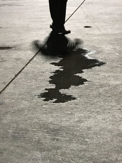The Street Photographer - 2017 EyeEm Awards Low Section Human Leg Real People One Person Shadow Lifestyles Standing Outdoors People Monochrome Photography Textured  Lines Monochrome