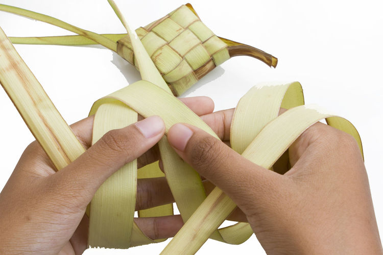 isolated rhombus in white background Celebration Event Hands Malay Traditional Food Rhombus Rice White Background Young Coconut Leaf
