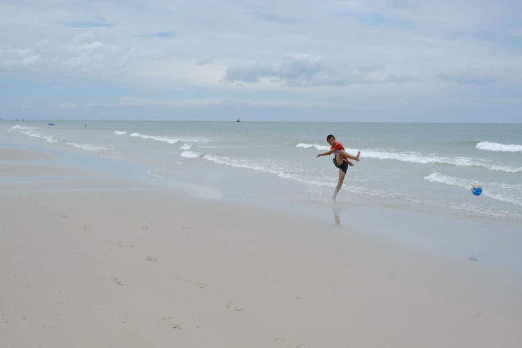 Man on beach against sky
