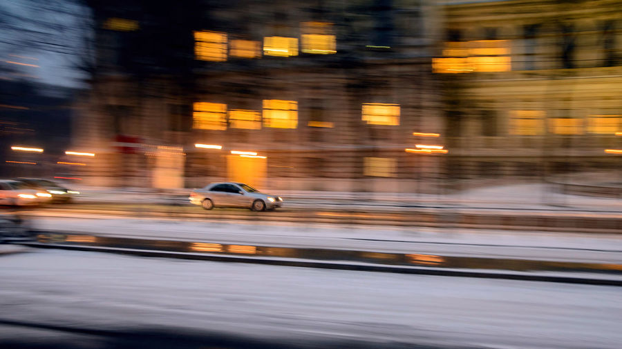 car moving fast in the night city in motion blur , evening Motion Blurred Motion Speed Transportation Mode Of Transportation Car City Architecture on the move Motor Vehicle Illuminated Night Street City Life Building Exterior Land Vehicle Travel Road Built Structure No People
