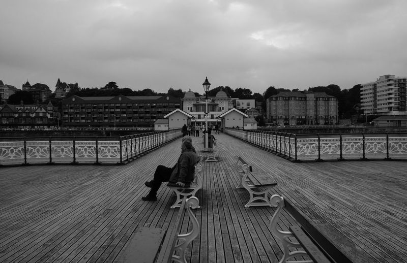 Penarth feels like a step back in time sometimes. Architecture Bench Benches Boards Cloud - Sky Couple Day Diminishing Perspective Outdoors Overcast People People Watching Pier Promenade Seaside Sky Walkway