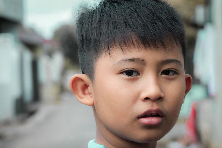 Close-up portrait of innocent boy