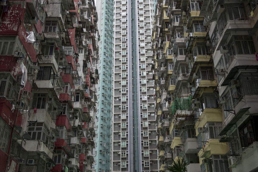 Hong Kong HongKong Apartment Architecture Backgrounds Building Building Exterior Built Structure City City Life Day Development Full Frame Hanging In A Row Location Low Angle View Modern No People Outdoors Place Residential District Window