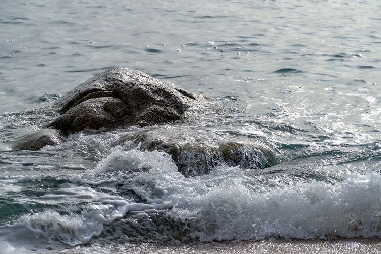 Sea waves splashing in a water