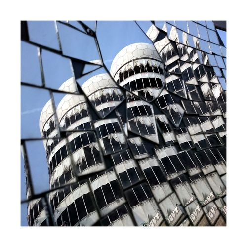 Architecture Building Exterior Built Structure City Tower Glass - Material Outdoors Famous Place Day Repetition Mirror Berlin Reflection Streetphotography Travel Photography Traveling Taking Photos Walking Around City Building Abstract Architecture Battle Of The Cities The Magic Mission Urban Geometry Discover Berlin