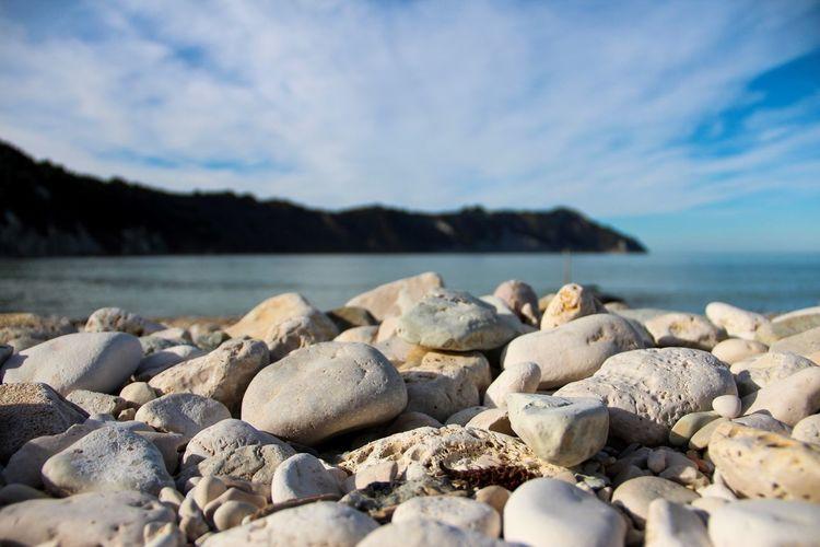 White stones on the beach Marche Adriatic Sea Top 10 Italy Ancona Conero Portonovo Mezzavalle Beach Sea Water Rock Solid Beach Nature Sky Sea Rock - Object Beauty In Nature Land Tranquility Cloud - Sky Tranquil Scene Scenics - Nature No People Stone Day Stone - Object Outdoors Pebble