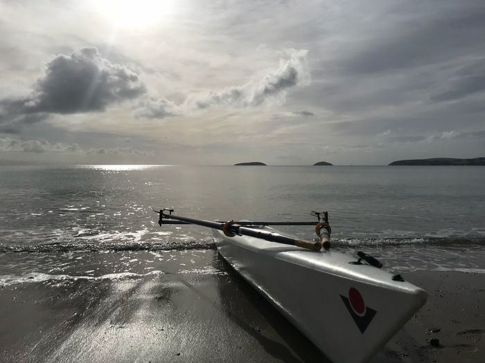 Rowing boat at dawn Bear Grylls Island Islands Rowing Boat On Water Skiff Sea Sky Cloud - Sky Beauty In Nature Scenics - Nature Rowing Boat On Water Skiff Sea Sky Cloud - Sky Beauty In Nature Scenics - Nature