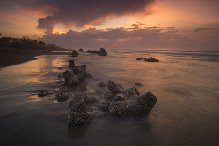 Beach Rocks Rocks And Water Sunset Scenery Warm Colors Pangasinan Pangasinan, Philippines DAGUPAN CITY