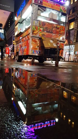 Mirror, mirror on the floor... Store Architecture Built Structure Illuminated People Adults Only Adult Nightphotography Mirror Reflection Water Reflection Hot Dog Stand New York Manhattan The Street Photographer - 2017 EyeEm Awards BYOPaper!