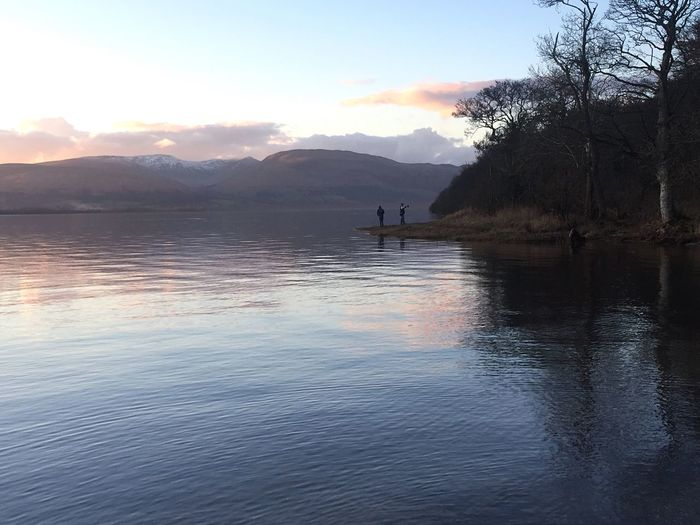 Outdoor Photography Naturelovers Unrecognizable People Takingselfies Nature On Your Doorstep Outdoor Life Dusk VisitScotland Lovelyview Water Landscape Rural Scene Waterfront Tranquil Scene Mountain Range