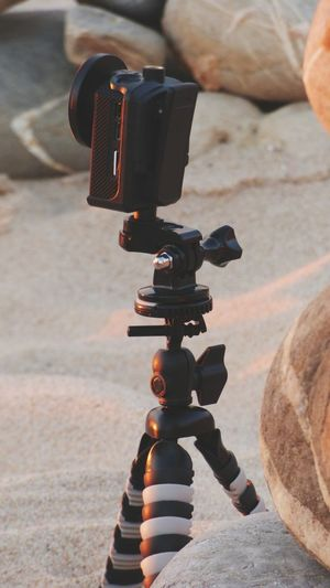 Close-up of action camera on tripod