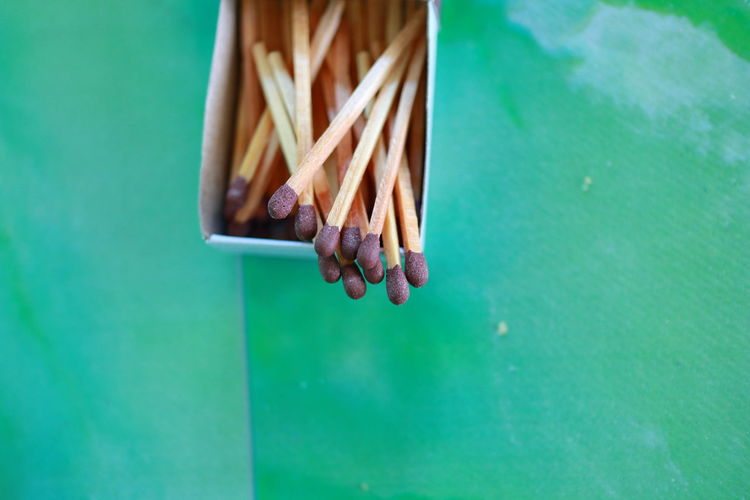 High angle view of matchsticks on table
