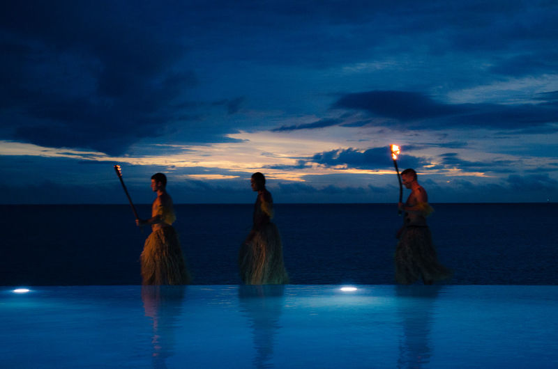 Walking on water Beauty In Nature Cloud - Sky Dusk Fiji Outdoors Real People Scenics Sea Standing Sunset Three Men Torches Traditional Costume Walking