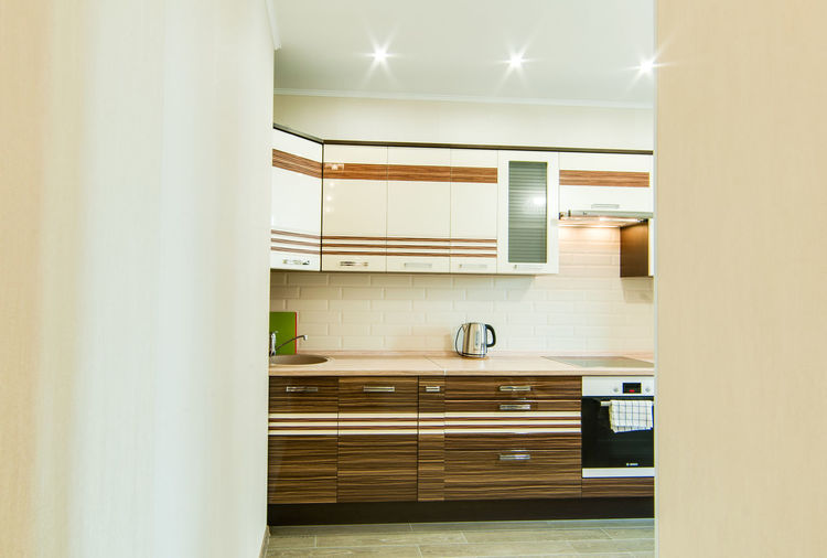 Indoors  Domestic Room No People Architecture Home Modern Furniture Cabinet Illuminated Kitchen Built Structure Wood - Material Lighting Equipment Domestic Kitchen Home Interior Empty Building Glass - Material Window White Color Clean Luxury Apartment