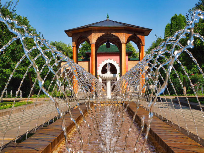 Jeans Brown Photography - Jeans Brown Photography Arch Architecture Bridge Bridge - Man Made Structure Building Exterior Built Structure Connection Day Flowing Fountain Motion Nature No People Outdoors Plant Sky The Past Travel Destinations Tree Water