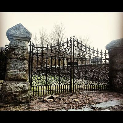 The old gate Asapacker Cemetery Victorian Mauchchunk gothic Episcopalian pillars greens stone walls ornate iron gate finials thehill