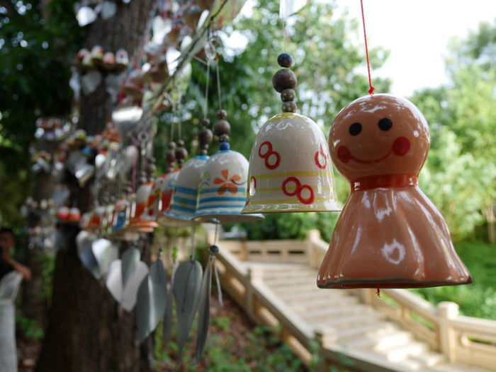 Close-up of decorations hanging in row outdoors