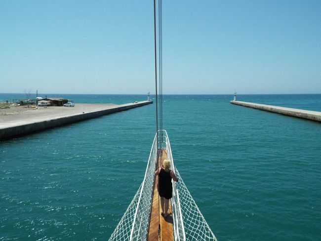 Where the river meets the sea Day Trip Travel Photography Travel Destinations Tourist Attraction  Tourism Blue Sky Blue Water Sea River Mediterranean Sea Manavgat River River Mouth Mouth Of Manavgat River Mouth Of The River Bowsprit People On The Way Finding New Frontiers Miles Away