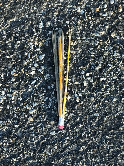 High angle view of pencils on road