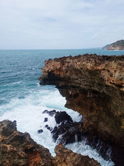 The waves hit a cliff on the island of timang, gunung kidul regency yogyakarta-indonesia