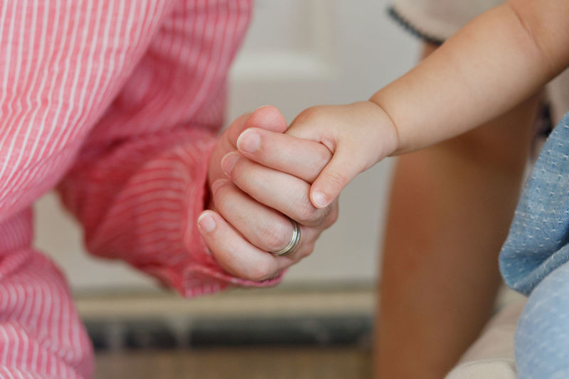 Daddy & Daughter Baby Care Daddy Daughter Time Holding Hands Soft Bonding Care Childhood Close-up Daddy's Girl Day Family With One Child Focus On Foreground Human Body Part Human Hand Indoors  Lifestyles Love Men People Real People Softness Togetherness