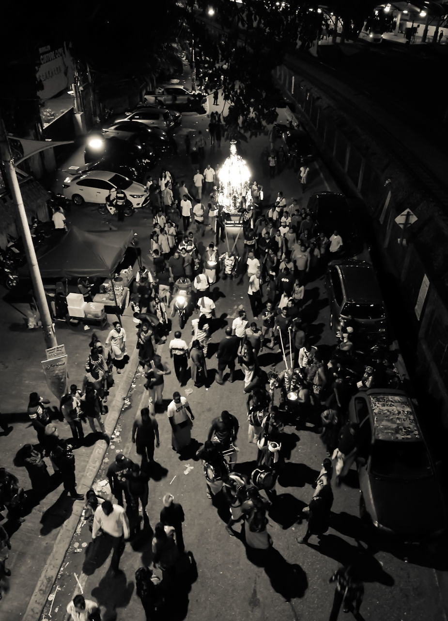 large group of people, real people, crowd, high angle view, lifestyles, women, men, street, leisure activity, mixed age range, enjoyment, night, city life, outdoors, built structure, togetherness, illuminated, architecture, audience, building exterior, city, people, adult