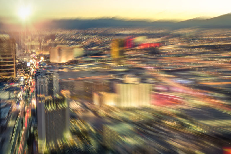Aerial view of Las Vegas skyline at sunset - Blurred city lights from downtown boulevard - Vintage filtered look with radial zoom defocusing Above Aerial America American Architecture Blue Hour Blurred Blvd Bokeh Boulevard Casino Cityscape Defocused Defocusing Downtown Dusk Entertainment Filtered Fun Gambling High Hotel Illuminated Las Vegas Lights Look Nevada Night Panorama Panoramic Radial Resorts Skyline Street Sun Sunset Sunshine Tourism Travel Twilight United States Urban USA Vacation Vegas  View Vintage Zoom