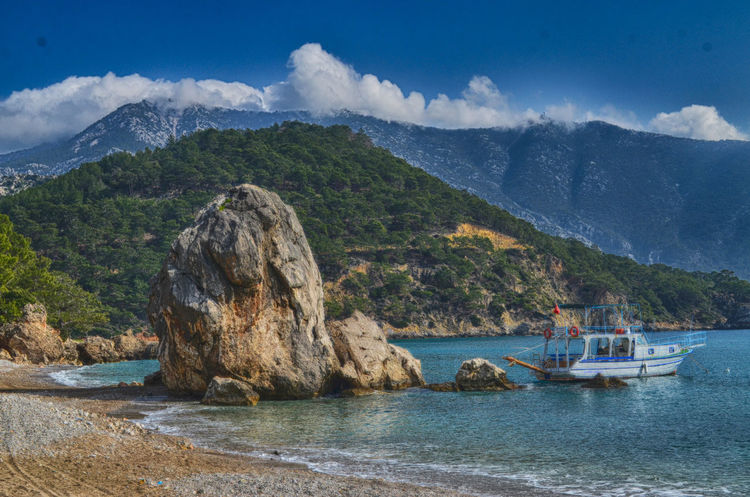 Find your own pier Mediterranean  Mediterranean Sea Lycianway Beuty Of Nature EyeEm Nature Lover HDR Hdr_Collection Hdrphotography Landscape_Collection Landscape Photography Stone Turkey Ships Mountains Mountains And Sky Sea Seascape Sea And Mountain Fishing Boat Buoy Fishing