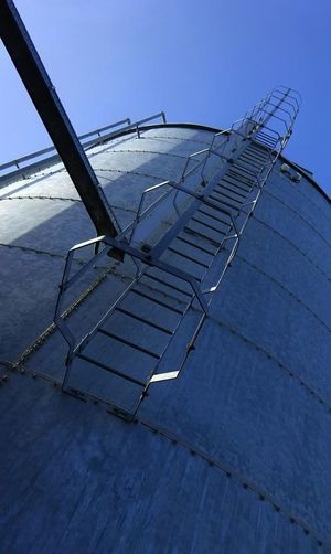 Into the blue Stairs Stairway Staircase Urban Structure Industrial Structure Ladder Tank Silo
