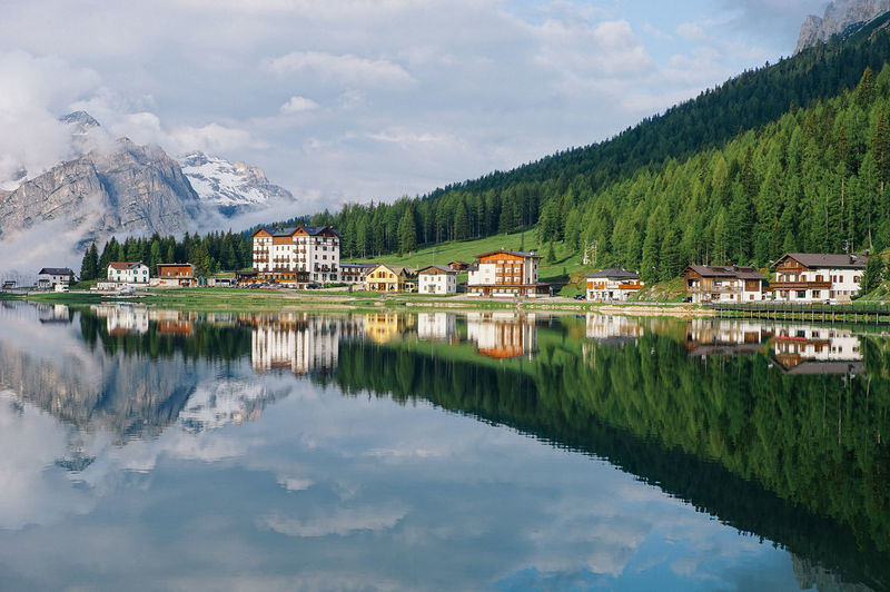 Lake Misurina, Italy Reflection Mountain Water Architecture Tree Built Structure Building Exterior Cloud - Sky Scenics - Nature Lake Building House Beauty In Nature Sky Waterfront Plant Nature Day Green Color Mountain Range No People Outdoors Italy Landscape_Collection Landscape_photography