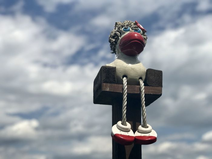Low angle view of cross statue against sky