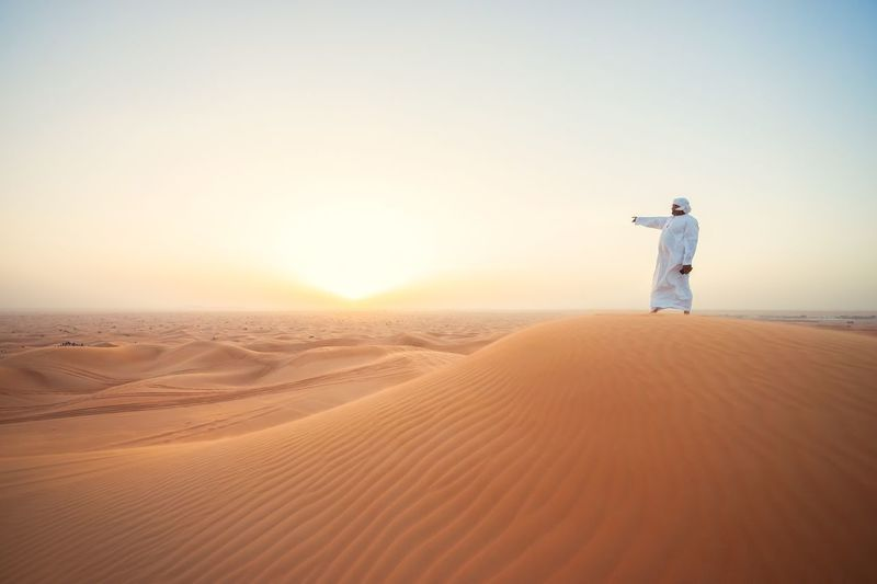 Finding New Frontiers Endless Desert Sand Full Length Desert Sunset Vacations Clear Sky One Man Only Adults Only One Person Adult Outdoors Only Men People Sand Dune Young Adult Day Eyesight
