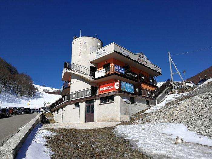 Snow Cold Temperature Sky Winter Nature Architecture Clear Sky Built Structure Day White Color Mountain Building Exterior No People Blue Water Frozen Covering Transportation Outdoors Snowcapped Mountain Roccaraso Ski School Ski Area Ski Runs Sangro
