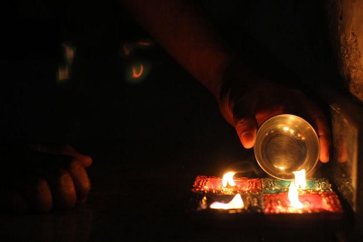 Happy Diwaali :) Burning Diwaali Highlight Diwali Diwali 2016 Diya - Oil Lamp Flame Heat - Temperature Human Body Part Human Hand Igniting Illuminated Night Oil Lamp One Person Outdoors People Light And Reflection