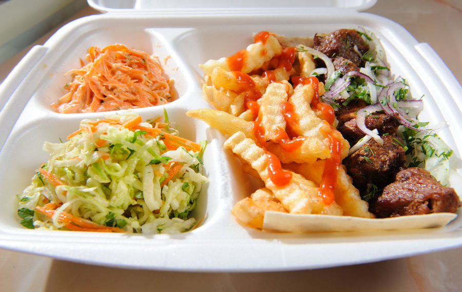 Polystyrene food foam tray with deep-fried potatoes,salads and meat Beef Dill Fast Food Feeding  Fries Herbs Lamb Pork Salad Tray Cabbage Carrot Deep Fried  Deep Fried Potatoes Fast Fat Food Junk Food Ketchup Mayonnaise Meat Potatoes Sauce Sauerkraut Vegetable