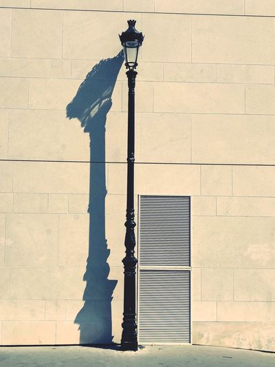 Street light against building in city