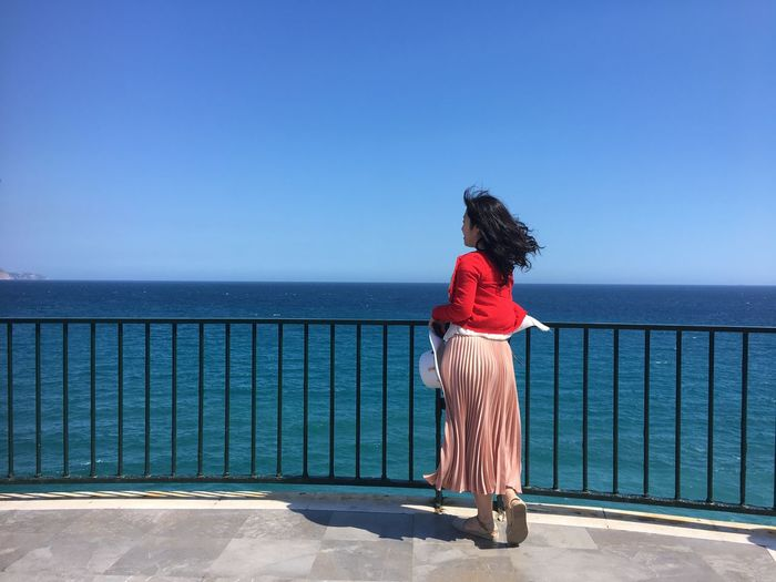 Balcony Nerja Spain Water Sea Rear View Women One Person Sky Blue Real People Standing Full Length Clear Sky Lifestyles Leisure Activity Day Nature