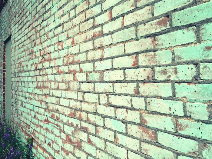 A beautiful wall to walk along Brick Wall Teal Bricks Beautiful Walls Backgrounds Doors Alleyway Blue Green Red