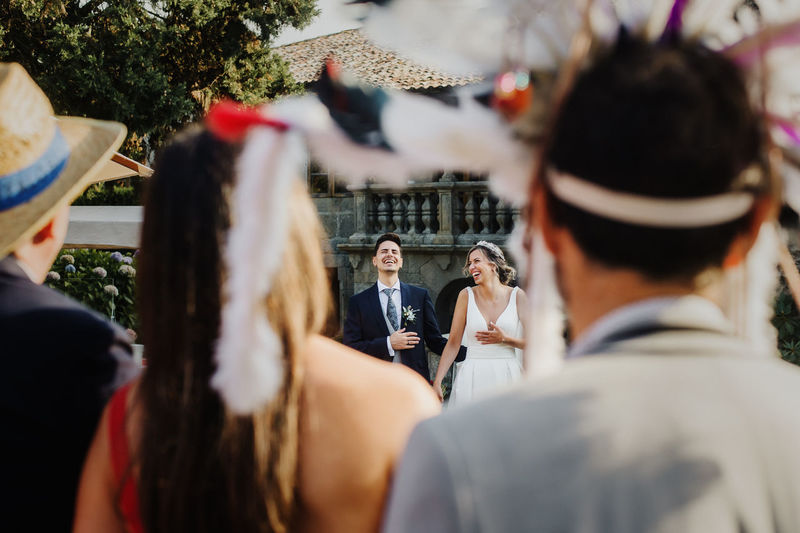 Couple seen through people during wedding