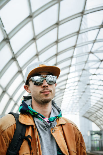 Portrait Of Young Man Wearing Cap Against Ceiling