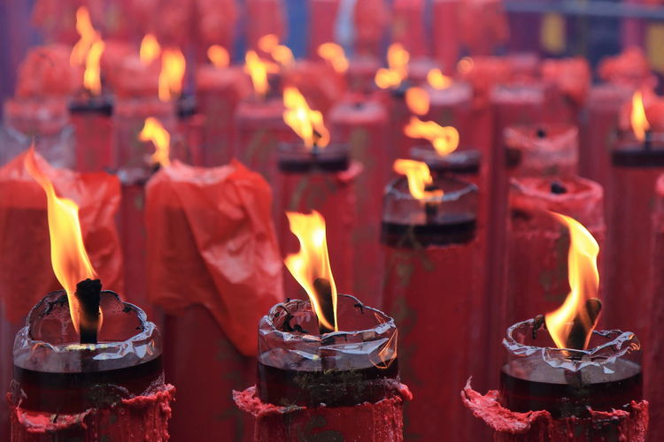 Lit candles in temple