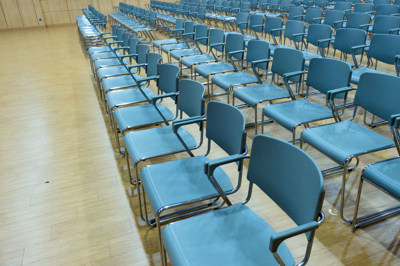 Absence Arrangement Auditorium Chair Classroom Day Empty Folding Chair Hardwood Floor In A Row Indoors  Large Group Of Objects Lecture Hall No People Office Chair Seat Table
