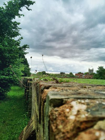 Ornamental Garden Slopes Grass The Moot Cloudscape Landscape Outdoors Cloud Sky Focus On Foreground Old Wall Village View Village History Historical Architecture Architecture Walls Weather Nature Home Is Where The Art Is Dramatic Angles