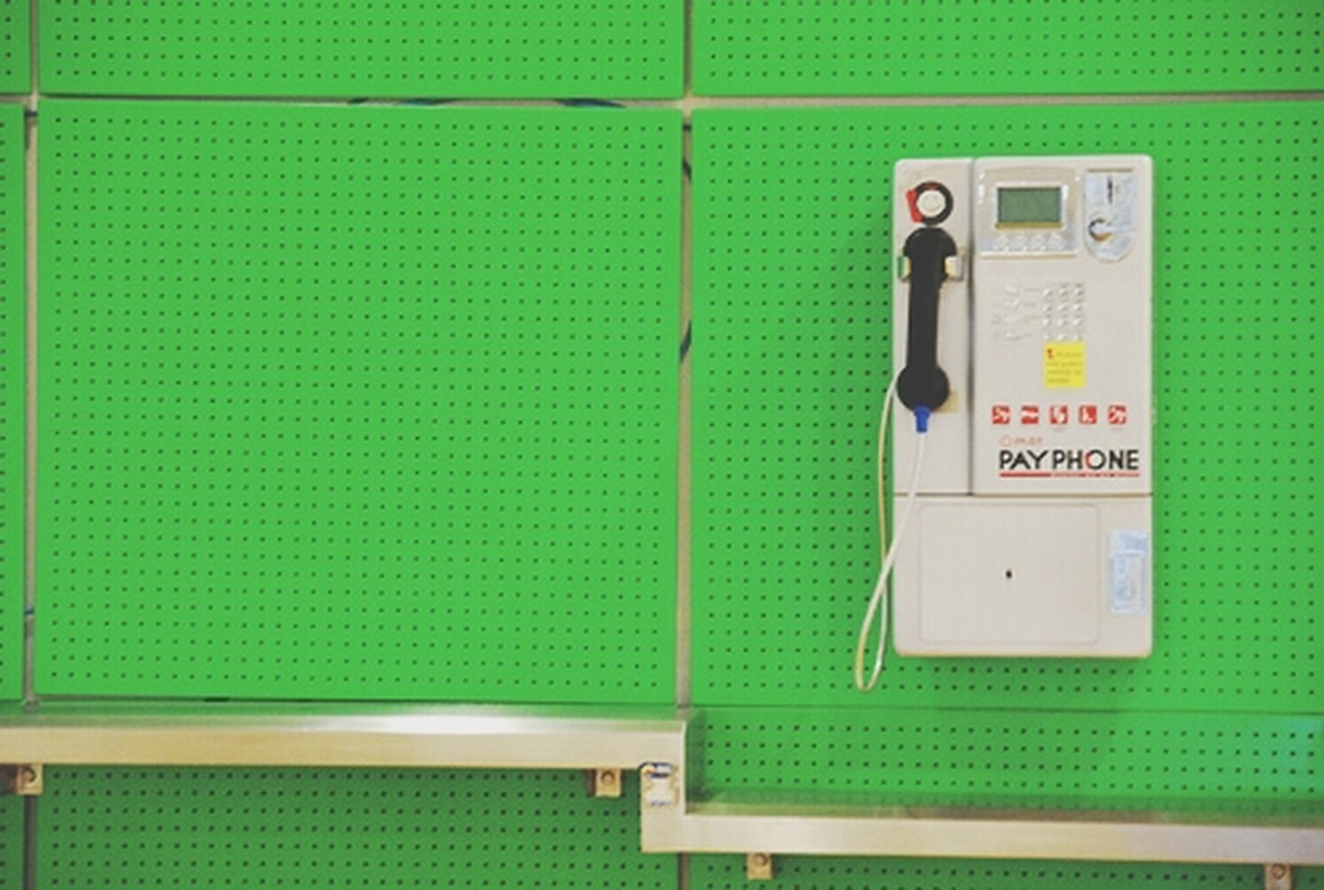 communication, indoors, wall - building feature, text, technology, western script, number, connection, blue, wall, door, close-up, closed, convenience, sign, safety, information sign, built structure, green color, guidance