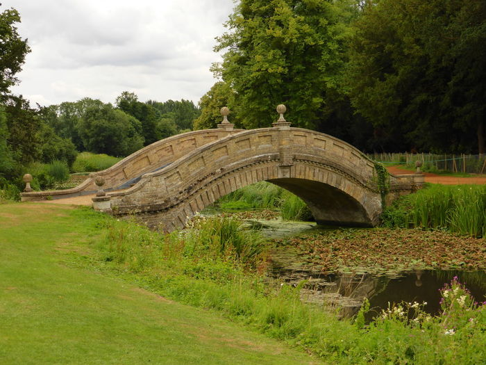 The Chinese bridge at Wrest Park, Bedfordshire Beauty In Nature Bridge Chinese Bridge Cloud Cloud - Sky Field Grass Green Green Color Idyllic Landscape Lush Foliage Nature Outdoors Sky Tranquil Scene Tranquility Tree Wrest Park