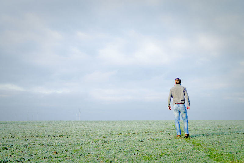 People Nature Real People Men Sky Landscape Rear View Day Field Standing Outdoors Grass Tranquility Art Is Everywhere Scenics Adult Beauty In Nature Lifestyles Full Length One Person Casual Clothing Cloud - Sky Break The Mold TCPM Tranquil Scene Green Color Growth Women Copy Space