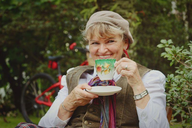 Portrait Of Smiling Senior Woman Holding Tea Cup